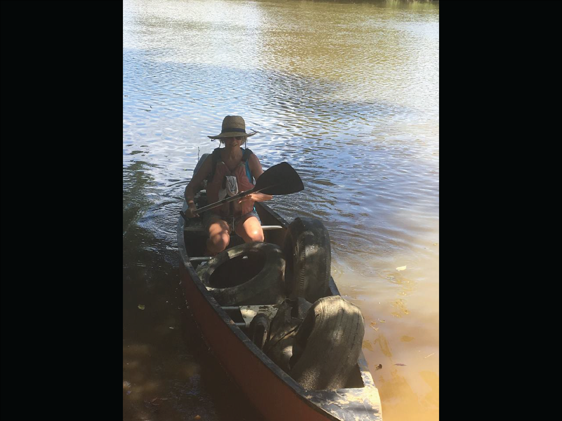 Tires in a canoe in the Dan River