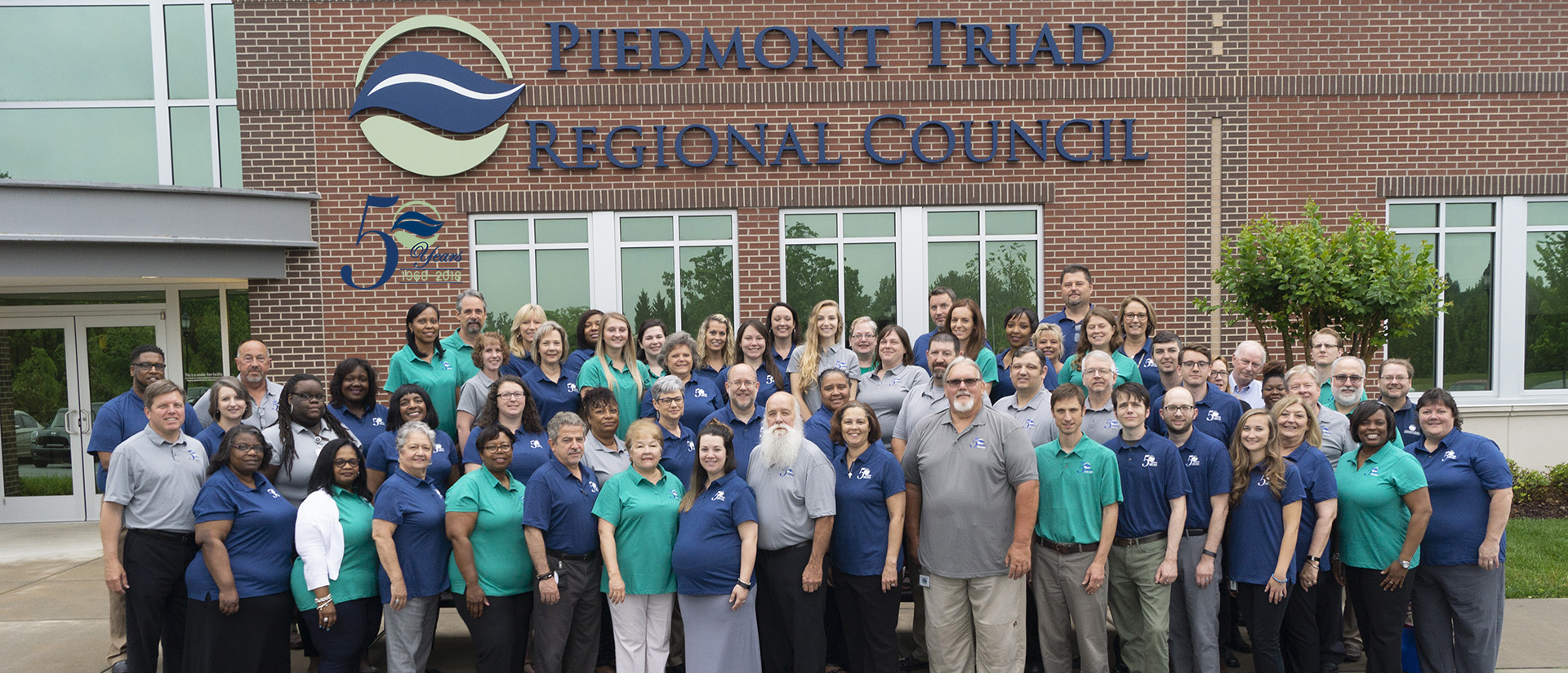 staff photo with 50th years logo embedded